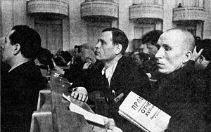 Pravda - A delegate at 17th Congress of the All-Union Communist Party (Bolsheviks) holding Pravda newspaper (1934)