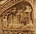 Depiction of Palaces and architecture, probably Kapilavastu Roundel 1 buddha ivory tusk.jpg