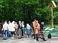 Devotees by Memorial to Murdered Priests - Babi Yar - Kiev - Ukraine (26963346591).jpg