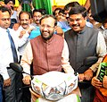 Dharmendra Pradhan and the Minister of State for Environment, Forest and Climate Change (Independent Charge), Shri Prakash Javadekar launching the Pilot Phase of CNG for Two Wheelers, at a function, in New Delhi.jpg