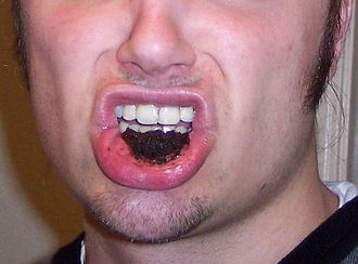 Smokeless tobacco - Dipping tobacco is placed directly in the mouth.