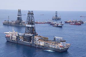 Timeline of the Deepwater Horizon oil spill (July 2010) - Discoverer Inspiration delivers the cap the spill on July 10. In the background are the Discoverer Enterprise, the Deepwater Driller II, and the Helix Producer I