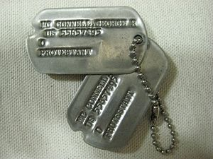 English: Military ID tag (dog tag), with PROTE...