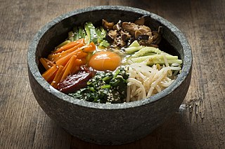 Bibimbap rice mixed with meat, namul, and condiments