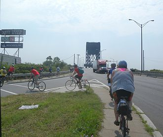 East Coast Greenway - Looking east as a Greenway tour approaches the bridge over the Hackensack River in New Jersey