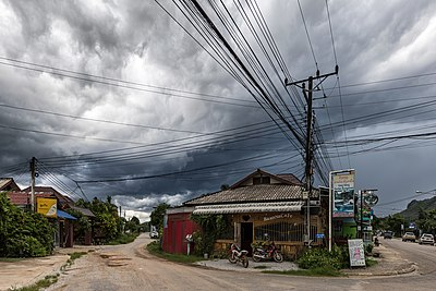 Electric atmosphere - Streetcorner with overhead power lines under a stormy sky in Vang Vieng, Laos.jpg