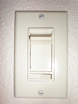 Dimmer -  A residential-type dimmer switch with sliding knob to change brightness. The device is small enough to fit into a regular wall box provided for a switch.