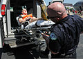 Emergency services personnel prepare to transport a mock victim during exercise Golden Eagle III at Stewart Air National Guard Base, Newburgh, N.Y., June 1, 2013 130601-Z-VX101-044.jpg