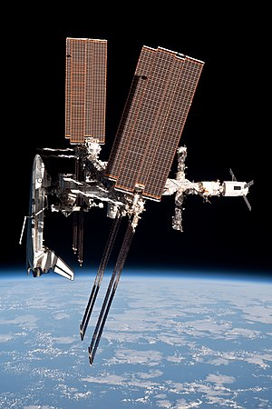 Expedition 28 - Space Shuttle Endeavour docked to the ISS on STS-134, imaged from the departing Soyuz TMA-20 spacecraft on 23 May 2011.