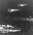 F-8E Crusaders of VF-62 fly over USS Claude V. Ricketts (DDG-5) in 1965.jpg