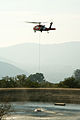 FEMA - 33326 - Helicopter picking up water to fight fires in California.jpg