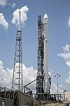 Falcon 9 carrying CRS-7 Dragon on SLC-40 pad (19045370790).jpg