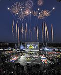 Fireworks erupt as the flags of 15 nations are displayed during the opening ceremony for the 2016 Invictus Games.jpg