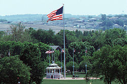 Flag over Offutt parade field.jpg