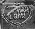 Forming a U.S. Coast Guard shield, high school students at Long Beach, California make a striking appeal for the... - NARA - 513223.tif