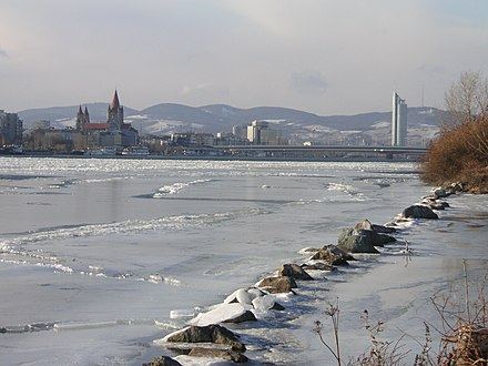 A look upstream from the Donauinsel in Vienna, Austria during an unusually cold winter (February 2006). A frozen Danube usually occurs just once or twice in a lifetime. Frozen Danube Reichsbrucke.JPG