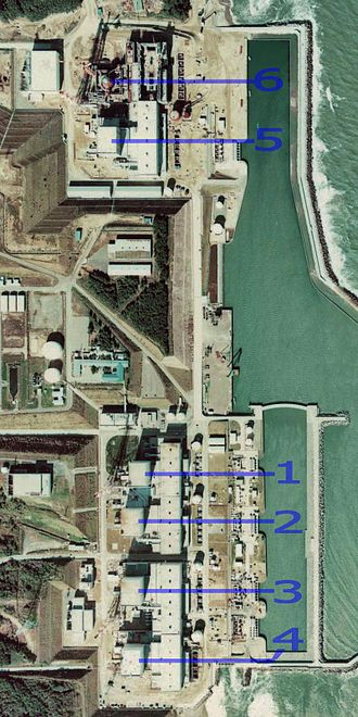 Fukushima Daiichi nuclear disaster - Aerial view of the station in 1975, showing separation between units 5 and 6, and 1–4. Unit 6, not completed until 1979, is seen under construction.