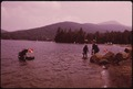 GROUP OF SCUBA DIVERS FROM A NEW YORK CITY CLUB AT BLUE MOUNTAIN LAKE, IN THE ADIRONDACK FOREST PRESERVE READY TO... - NARA - 554613.tif