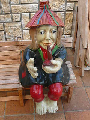 Garden gnome with smoking pipe