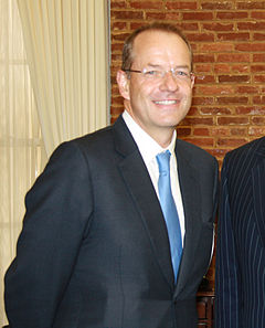Andrew Witty wearing a suit