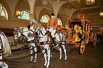 Coronation of Queen Victoria - The Gold State Coach, drawn by eight horses, in the Royal Mews