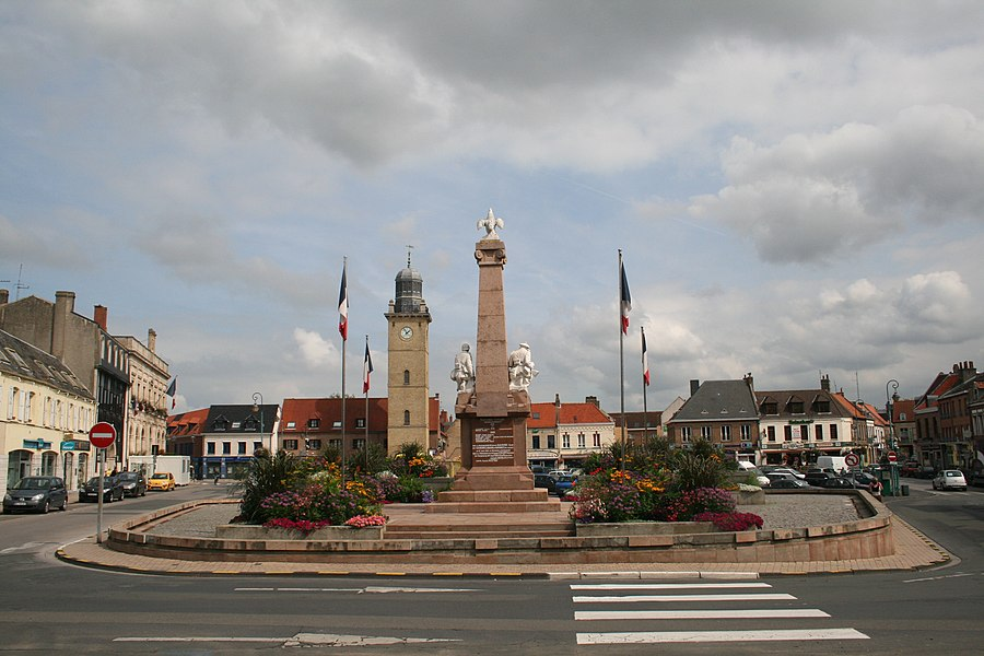 Gravelines (Nord) France, Place Charles Valentin with the city hall, the belfry and the war memorial and veterans of wars 14-18 and 39-45.