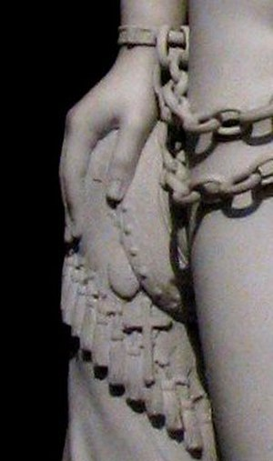 The Greek Slave - Detail of the statue's hand, showing the cross and locket.