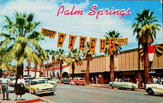 Palm Springs, California - A postcard of Palm Canyon Dr. through Palm Springs' downtown village in the 1950s