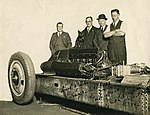 "Group and a cat inspecting the car ""F.H. Stewart Enterprise"" (4986019504).jpg"