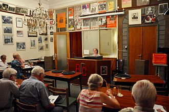 """Antwerp Jazz Club (AJC) - Guy Van Looy presenting his multimedia blues presentation entitled """"Portraits in Blues 57: The SPIVEY RECORD LABEL"""" at the Antwerp Jazz Club (AJC) on 13 September 2016. Marc Vanistendael can be seen in the far left of the picture."""