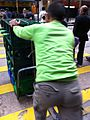 HK Yau Ma Tei Nathan Road AS Watsons distilled water bottle Logistics staff worker green uniform morning Feb-2014.JPG