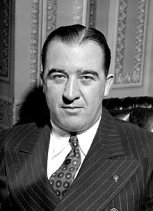 A black and white photo of a man in his forties wearing a suit