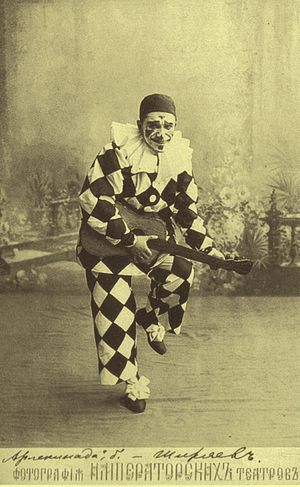 Les millions d'Arlequin - Alexander Shiryaev as Harlequin in Les millions d'Arlequin in his costume for the first act. Here, Shiryaev is holding a prop guitar from the ballet's famous Sérénade. St. Petersburg, ca. 1905