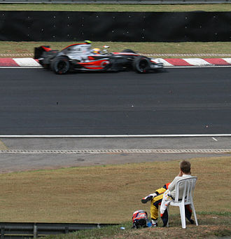 2007 Brazilian Grand Prix - Kovalainen (in chair at front of picture) retired (DNF) a race for the first time in Formula One.