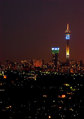 Hillbrow - Hillbrow Tower (right) with Ponte Apartment building and the skyline of Hillbrow.