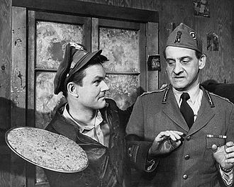 Hogan's Heroes - Hogan tries to influence visiting Italian Major Bonacelli (Hans Conried) into helping him.