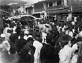 Holiday crowds and A woman in kimono sits on a float around 1910s, Photo-No.5156.jpg
