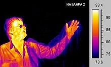 Infraroodbeeld van een mens in valse kleuren  Vooral het hoofd is