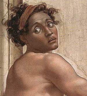 Sistine Chapel ceiling - The evidence of the plaster laid for a day's work can be seen around the head and arm of this ignudo