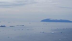 Illorsuit Island - The southern part of Illorsuit Island seen across the northeastern part of Uummannaq Fjord, from the western ridge of the Nunaarssuaq mountain on the Ukkusissat Peninsula.