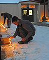 Indian Army soldiers light candles during a Diwali festival celebrated with Soldiers from the U.S. Army Alaska at the Wilderness Inn dining facility on Joint Base Elmendorf-Richardson, Alaska in 2010.jpg