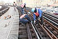 Installing plates and rails on F line (11294191043).jpg