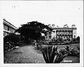 Iolani Palace with a view of the Royal Bungalow (PP-11-2-014).jpg