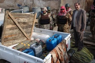 Improvised explosive device - Artillery shells and gasoline cans discovered in the back of a pick-up truck in Iraq