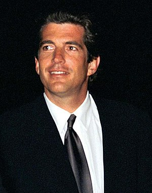 John F. Kennedy Jr. greets invited guests at t...