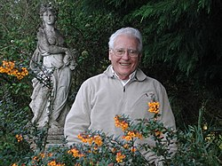 James Lovelock in front of a statue of Gaia in 2000