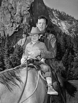 James Arness - Arness with his son, Rolf, in 1959.