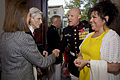 Jeanne Vander Myde Warner, left, the wife of retired U.S. Sen. John Warner, center left, the Evening Parade guest of honor and a former secretary of the Navy, exchange greetings with U.S. Marine Corps Sgt. Maj 130503-M-LU710-103.jpg