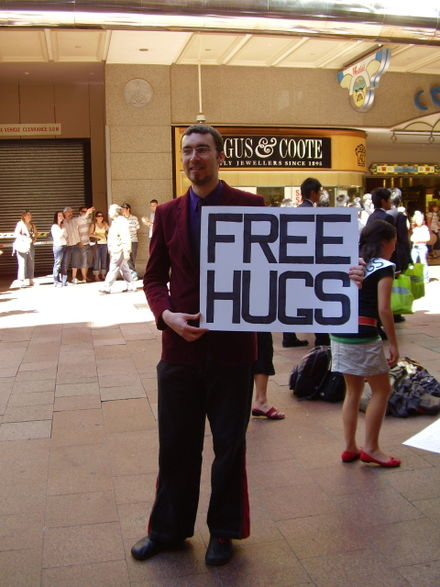 Juan Mann, who started the Free Hugs movement, seen at Pitt Street Mall, Sydney, Australia, 2006 Juan Mann.jpg