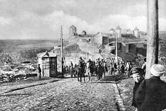 Operation Faustschlag - Austro-Hungarian troops enter Kamianets-Podilskyi, Western Ukraine with the city's iconic castle in the background